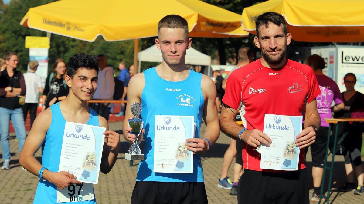 Gewinner über fünf Kilometer: Lukas Botrus (v. l.), Ben Althoff und Jens Brodka. Fotos: Kreisel
